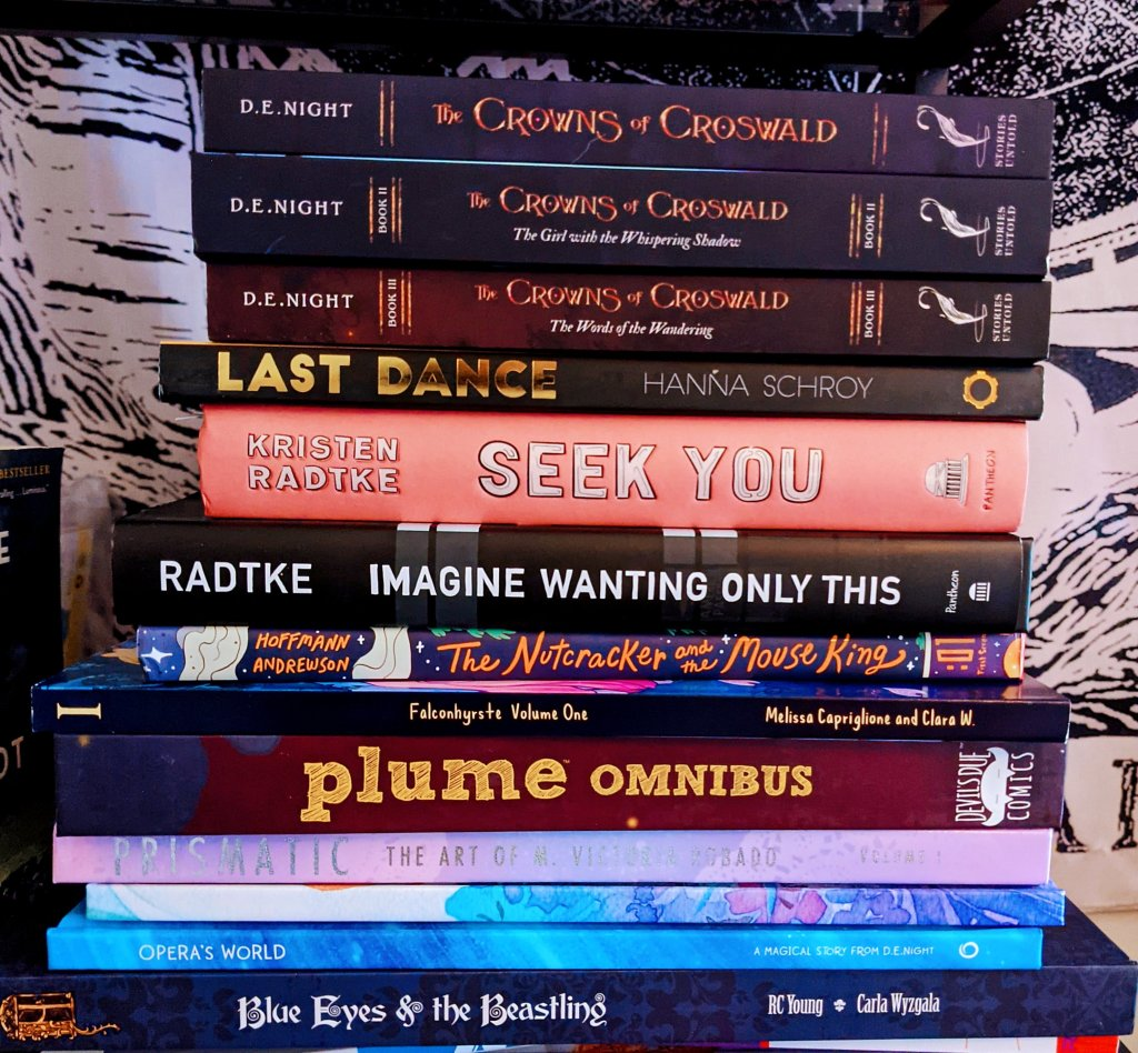 Miss Moody Lilac stack of books purchased at NYCC 2021